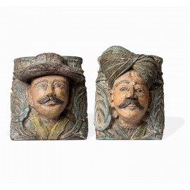 Two carved corbels of tropical wood