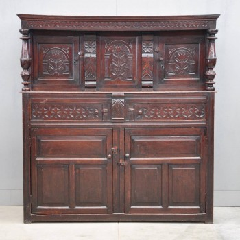 English carved press cupboard