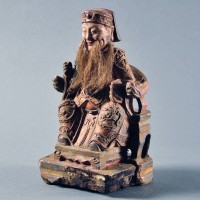 Antique chinese wood figure of a seated court official