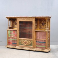 A Continental carved giltwood marble top cabinet
