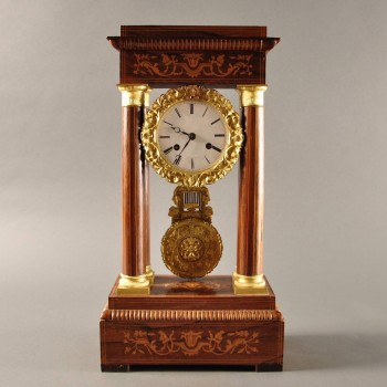 Antique Charles X, rosewood / marquetry portico mantel clock with ormolu mounts.