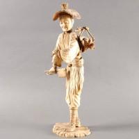 Japanese Okimono ivory of a standing woodsman
