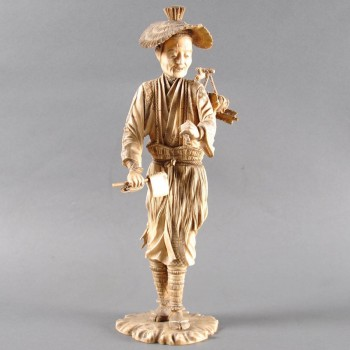 Japanese Okimono of sectional ivory of a standing woodsman