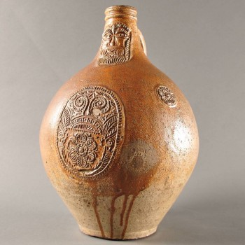antique Bellarmine jug, stoneware covered in ferruginous glaze