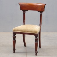 Eight British mahogany rail back dining room chairs