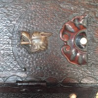 Carved writing cabinet with brass fox heads