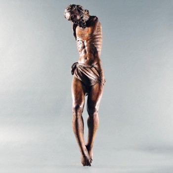 Tall Figure of christ crucified, carved of walnut