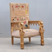 Gothic style armchair with carved giltwood and upholstered