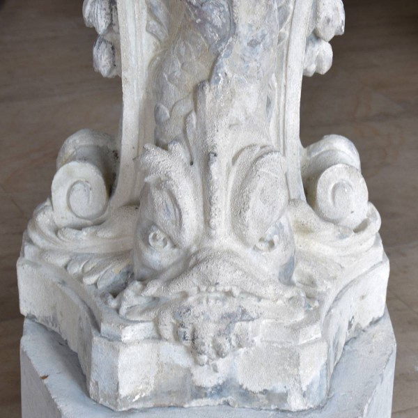 Carved Stone Fence : Wall fountain out of carved stone fish shell figures