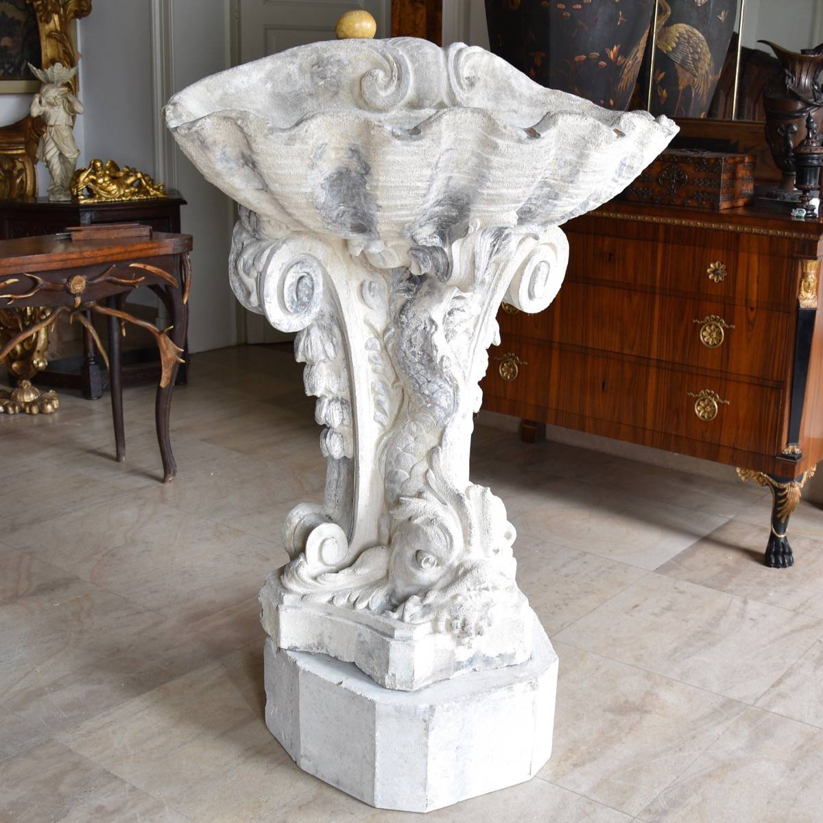 Carved Stone Base : Wall fountain out of carved stone fish shell figures