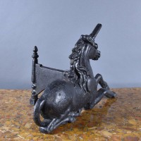 Unicorn Andirons / boot scraper