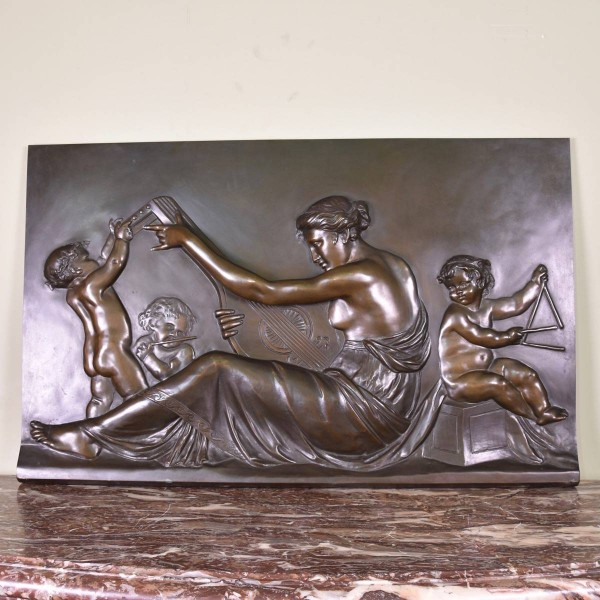 bronze panel of a musical scene