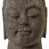 Buddha head carved stone
