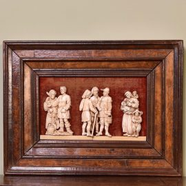 Carved relief of Villagers