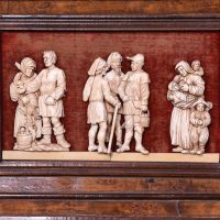 Finely carved relief of villagers