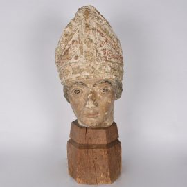 Carved Stone of a Bishop Head
