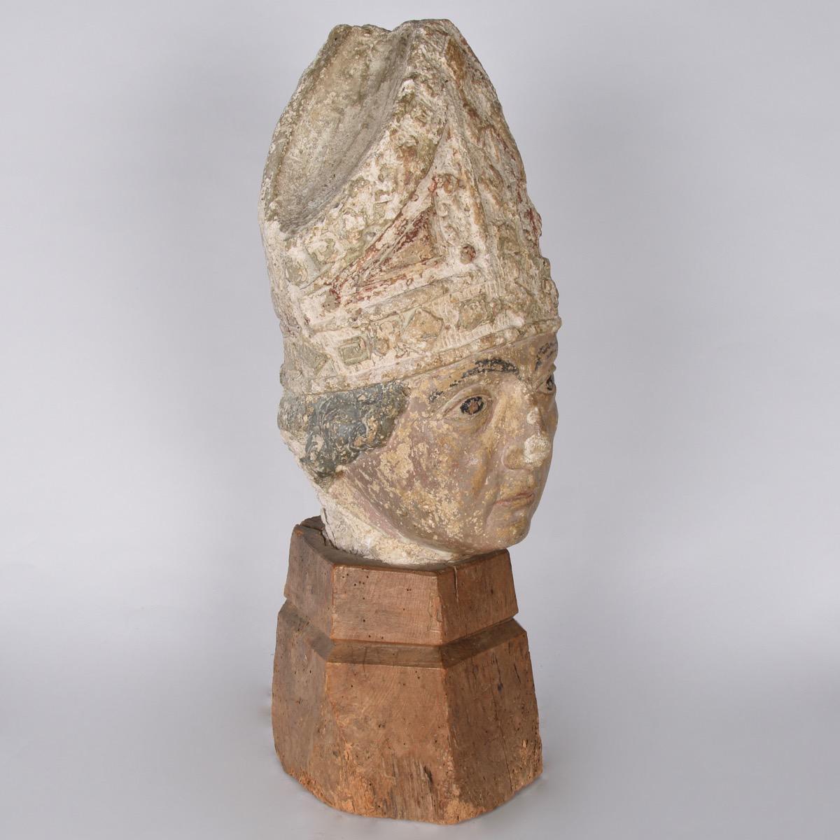 Carved stone of a bishop head paul de grande antique