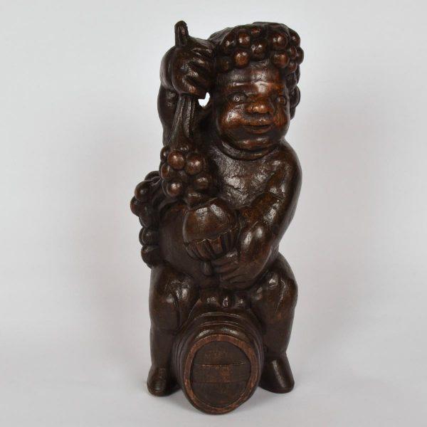 Carved oak figure of Bacchus