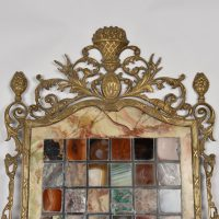 Marble collection panel with bronze frame