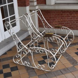 pair of painted wrought iron garden chairs