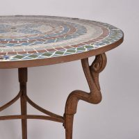 cast iron table, inlaid stone top
