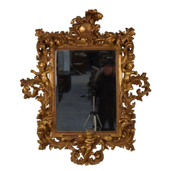 elaborated carved gilded mirror